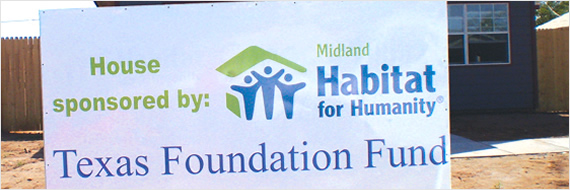 Habitat for Humanity sign in front yard of home